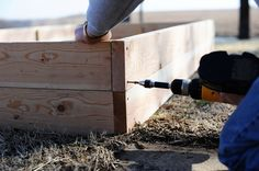 Simplified step by step instructions and materials needed for making a raised bed.