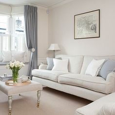 Like the rest of the house, the living room is decorated in soothing cream and stone shades, with just a hint of colour in the dress curtains. A window seat with hidden storage was added to the bay - great when extra seating is needed and for tidying away clutter. Half-height shutters keep the light flowing in, while providing privacy from passers by. Similar sofa, Sofa.com, Similar footstool, The Dormy House.: