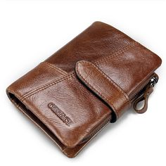 Men Real Cowhide Leather Hasp Zipper Trifold Short Wallet. This stylish clutch is multi-purposed, it may be a good choice as a wallet, card holder or as a gift to your friends or family members. One large compartment, two photo compartment, one removable zipper compartment and seven credit card slots. Store your card and cash orderly. High grade wax top layer real cowhide leather material is great for durability. Allows you to button up when you're not using it to ensure everything stays ins