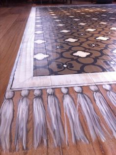 Image result for painted rug on wood floor