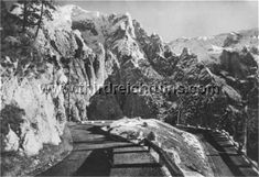 The Kehlstein road was and is an engineering marvel. The six kilometer road (slightly over four miles) was blasted into the mountainside, rising some 2700 feet, and using only one switchback curve (and another almost so). The road (along with the Kehlsteinhaus) was built in only 13 months. The switchback, called the Scharitzkehl curve (overlooking the Scharitzkehlalm valley) is shown above in a 1940s postcard