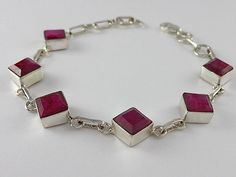 Unique sterling silver bracelet with faceted natural ruby gemstone and fine details throughout.