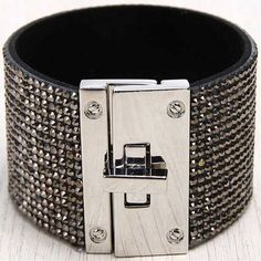 Make a bold, edgy statement with this sleek leather cuff embellished with an ornate crystals Unique turn buckle closure Wide band bracelet Various tones of metals in this beautiful bracelet #affiliatepin