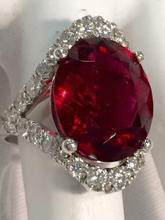 rubellite tourmaline ring haloed and shanked with GSI diamonds in white gold. rubellite tourmaline ring haloed and shanked with GSI diamonds in white gold. Ruby Jewelry, Gemstone Jewelry, Jewelry Rings, Fine Jewelry, Bijoux Art Deco, Beautiful Rings, Ring Designs, Rolex, Vintage Jewelry