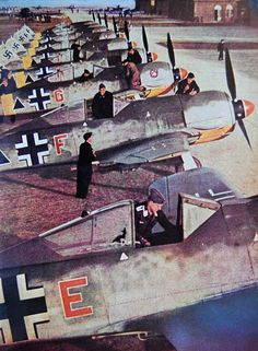 A complete squadron of new Focke Wulf Fw 190 fighters receive the finishing touches before being delivered. These aircraft used a powerful air-cooled radial engine, whose excess of power was intended to compensate for the loss of aerodynamics caused by their flat nose. The water-cooled in-line engines used by the more aerodynamical Me Bf 109 fighters were not available for Focke Wulf when the design of its new aircraft began.