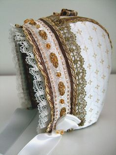Christening bonnet, decorated with lace and beads. Handmade by Lill Venke Hustvedt