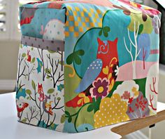 Tutorial to make this cute sewing machine cover at Notes from the Patch. This blog has other terrific sewing project tutorials.
