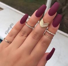 Maroon nails with stylish rings and it's a very classy look to go to dinner or a movies!!!