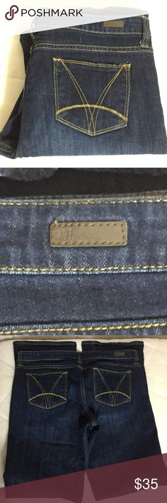 """Kut from the Kloth Farrah Baby Bootcut Size 10 Darker wash Embroidered rear pockets in yellow orange thread. One button closure at waistband  See materials and wash instructions in the pictures above.  Approximate measurements laying flat. Waist 16"""" Rise 9.5"""" Inseam 32"""" Leg opening 9"""" Kut from the Kloth Jeans Boot Cut"""