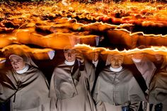 Torchlight Procession in Lourdes, France. Photograph by Laurent Etcheverry