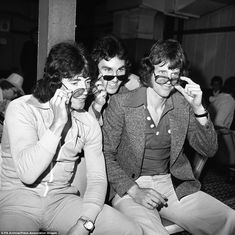 (L-R) England's Kevin Keegan, Gerry Francis and Mick Channon take it easy at Heathrow Airport before flying to Glasgow for the final match of the British Championship