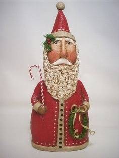 This nice Santa stands 11 inches tall and is made from a papier mache /sawdust mixture scuplted over a clean plastic container. He has been