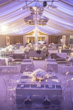 Paris meets Dallas wedding inspiration via http://diannvalentine.com/news/files/2012/12/Overall-Tent-Stage-View.jpg || Create similar white wedding centerpieces with silk flowers from Afloral.com! -repinned from LA County wedding minister https://OfficiantGuy.com #weddingofficiant #losangelesweddings
