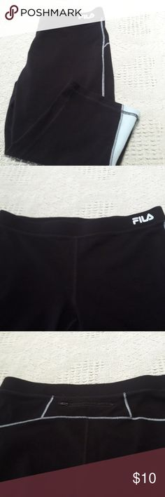 Fila black yoga capris, medium Exercise yoga workout capris by Fila Size medium Elastic waist Capri length Black and aqua trim Pants Capris