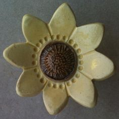 Yellow Sunflower Knob for Cabinet or Dresser $11.50  http://www.knobs.co/knobs/yellow-sunflower-knob-w-brown-center-_ACH-F-PT02-3A-9A-K.php  #knob #sunflower #yellow