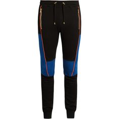 Balmain Biker stitched-panel jersey track pants ($609) ❤ liked on Polyvore featuring activewear, activewear pants, black multi, track pants, balmain and bike jerseys
