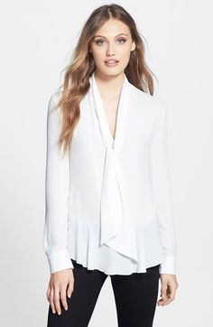 Free shipping and returns on Vince Camuto Ruffle Hem Tie Neck Blouse at Nordstrom.com. A soft and feminine blouse in silky georgette is fashioned with flowy ties at the V-neckline and a gently ruffled peplum hem.