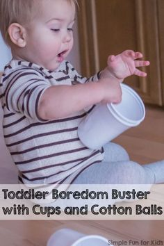 Quick and simple activity to keep your toddler busy with minimal supplies: Toddler Boredom Buster with Cups and Cotton Balls