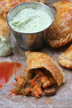 Recipe for langostino and Andouille sausage empanadas inspired by the flavors of Louisiana. These spicy empanadas can also be made with crawfish or shrimp, and are served with an avocado cilantro dipping sauce. Seafood Recipes, Cooking Recipes, Healthy Recipes, Seafood Dishes, Chorizo, Langostino Recipes, Sauces, Creole Recipes, Salads