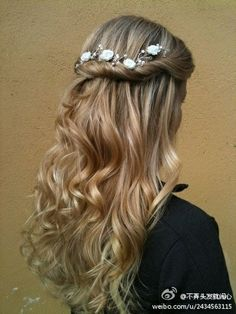Romantic hairstyle with long loose curls, and a twisted side wrap.