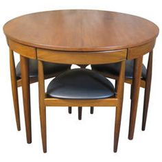 Love the way the chairs nest under the table. Hans Olsen for Frem Rojle Teak Dining Table and Chairs, Mid-Century Modern