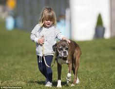 Steady hand: Mia gives Spey an affectionate pat on the  back as they stroll across the gra...
