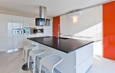 Modern, Minimalist kitchen with a splash of colour in France