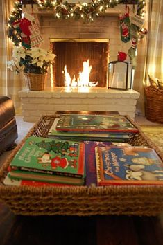 put christmas books in a basket on coffee table