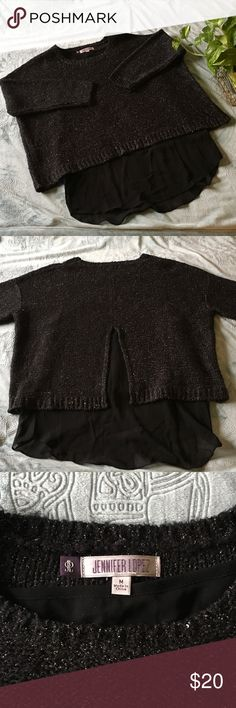 Jennifer Lopez 2piece swing sweater Black sparkle Jennifer Lopez 2piece swing sweater with 3/4 sleeves, and sheer mesh under layer. Size m but fits like a large. Worn only a couple times. Jennifer Lopez Sweaters Crew & Scoop Necks