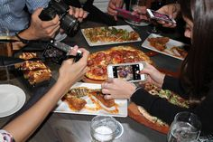 Instagram users photograph dishes during a dinner at Del Frisco's Grille New York. Professional food Instagrammers, courted by restaurants for their six-figure followings and stylish photography, turn their social-media accounts into professions.