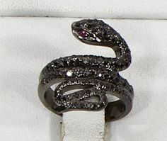 Snake design Ring with oxidized Pave Diamonds