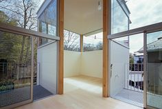 Umbre architects has completed 'house in tutujigaoka' designed for a family of four – a couple and their two children. The structure comprises three cuboid volumes oriented around central communal areas. The ground floor features the bedrooms and a tatami room, while living accommodation is spread across the upper level.  http://www.designboom.com/architecture/umbre-architects-house-in-tutujigaoka-tokyo-japan-03-29-2014/