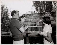 0 Esperanza Baur and John Wayne with a parrot in a cage