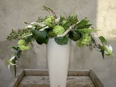 green and white flower arrangement with armature