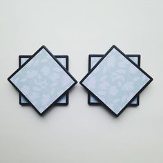 New today!  Chalkboard tile coasters in pale blue/green floral print.  Lovely for your spring/summer decor!