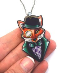 Felix is a dapper lad with his bowler hat and monocle. This quirky fox necklace measures 55mm tall and would complete a vintage, rockabilly or retro outfit.