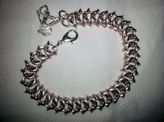 First chainmaille piece I made with silver and rose gold rings with Herkimer diamonds. It feels so soft and looks great.