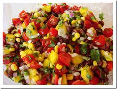 Black Bean Fruit Salsa 1 cup black beans, drained & rinsed 1 cup corn 3-4 tomatoes, chopped (or 2 cups quartered cherry tomatoes) 1-2 mangos, nectarines, or peaches, chopped 1 hot banana or jalapeno pepper, minced 1 small red onion, finely chopped 5 green onions, sliced 3 Tbs fresh lime juice 2 garlic cloves, minced 2 Tbs olive oil 1/2 bunch cilantro, finely chopped ½ tsp salt Combine all ingredients. Toss gently. Serve with tortilla chips or as a condiment to grilled chicken or fish.