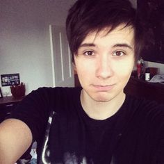 Dan Howell  danisnotonfire on youtube :)  Woah, hairstyles switched direction... Mind.... Turmoil...