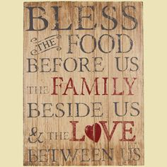 "Made with distressed wood, black and red paint. Bless the food before us, the family beside us and the Love between us!Measures 24"" x 18"" .5""."