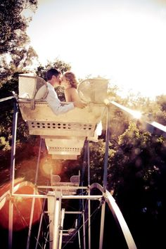 Ferris Wheel--- the exact place I want to be proposed to....maybe..would be cute, especially if it was my first time on one!