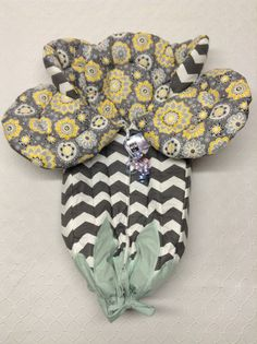 Baby bunting. Gray and white chevron outside with yellow gray floral inside