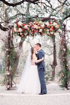 Romantic spring garden fresh look ceremony arch - bright pinks and fuchsias Whim Florals | Camp Lucy | Sacred Oaks | photography by http://www.michelleboydphotography.com | Featured on http://www.elizabethannedesigns.com/