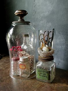 Make your own cloche. Flip a large vase over and attach a lovely worn vintage door knob.