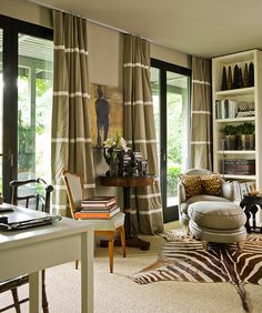 Single color drapery panels banded with white; zebra rug