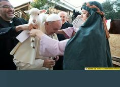 Holy Father carrying a lamb during His visit to a live nativity scene