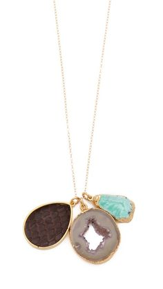 We love Dara Ettinger's jewelry and this charm necklace is so fun.
