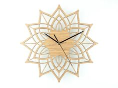 This modern wall clock is called Contemporary Flower. The delicate design fits well in a modern or traditional home and the natural colour goes with any room colour scheme, from natural to bright and bold.   The clock face is laser cut from eco friendly solid bamboo.  Outside diameter of clock face is 28 cm (11) and protrudes 2.5 cm (1) from the wall.  The clock mechanism is a quartz sweep type which means its virtually silent, no ticking, and comes with black metal hands.  Comes complete…
