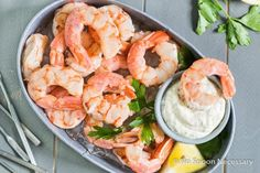 Juicy, succulent beer poached shrimp cocktail served with creamy remoulade sauce.