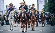 The Argentine Army Regiment of Mounted Grenadiers (Regimiento de Granaderos a Caballo) riding down Avenida Roque Sáenz Peña in Buenos Aires at the 2010 Argentine Bicentennial National Day Parade.